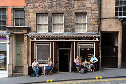 Edinburgh, Scotland, UK. 12 July, 2020, Business slowly returning to normal in Edinburgh city centre. Tourists still almost non existent and streets remain very quiet in the Old Town. Outdoor seating areas of cafes are now open in the Old Town such as this one on West Bow where cars are now prohibited. Iain Masterton/Alamy Live News
