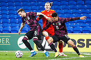 Wales forward Gareth Bale (11) is put under pressure by Mexico midfielder Héctor Herrera (16) and Mexico defender Jorge Sánchez (8) during the international friendly match between Wales and Mexico at the Cardiff City Stadium, Cardiff, Wales on 27 March 2021.