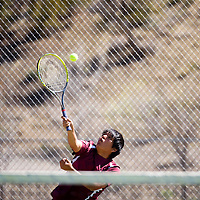 041513    Brian LEddy<br /> Rehoboth Lynx Chris Yazzie serves the ball during a doubles match against Gallup Monday afternoon.