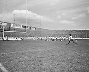 Children take turns hitting the slitor towards the goal during their visit to Croke Park during a Kells Educational Tour on the 25th June 1976.