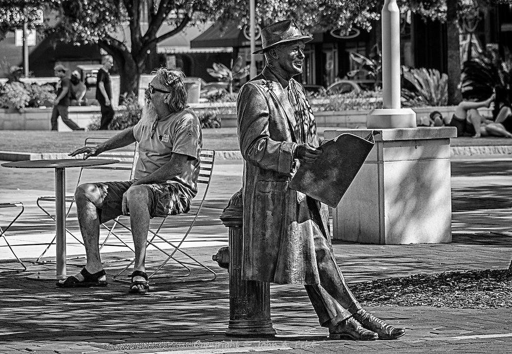 I got a big kick out of how these two were positioned.  The fellow with the newspaper is bronze, not a street performer.