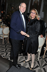 The EARL OF DARTMOUTH and his wife FIONA at a dinner and dance hosted by Leon Max for the charity Too Many Women in support of Breakthrough Breast Cancer held at Claridges, Brook Street, London on 1st December 2011.