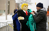 Chris Ihle unwraps a likeness of U.S. President Donald Trump he made out of 44,000 plastic blocks outside a Trump rally in Des Moines, Iowa, U.S., January 30, 2020. REUTERS/Rick Wilking