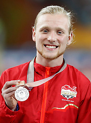 England's James Arnott with his silver medal in the Men's T47 100m final, at the Carrara Stadium during day nine of the 2018 Commonwealth Games in the Gold Coast, Australia