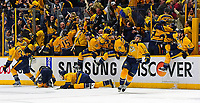 NASHVILLE, TN - MAY 05:  Players and coaches on the Nashville Predators bench erupt in celebration after winning 4-3 in the third overtime period of Game Four of the Western Conference Second Round against the San Jose Sharks during the 2016 NHL Stanley Cup Playoffs at Bridgestone Arena on May 5, 2016 in Nashville, Tennessee.  (Photo by Frederick Breedon/Getty Images)