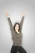 Digitally enhanced image of a success. Smiling young woman raises her arm On white Background
