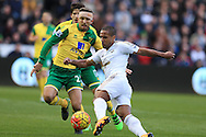 Wayne Routledge of Swansea city is challenged by Gary O'Neil of Norwich city. Barclays Premier league match, Swansea city v Norwich city at the Liberty Stadium in Swansea, South Wales  on Saturday 5th March 2016.<br /> pic by  Andrew Orchard, Andrew Orchard sports photography.