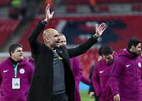 Football - 2018 Carabao (EFL/League) Cup Final - Manchester City vs. Arsenal<br /> <br /> Pep Guardiola, Manager of Manchester City, takes the plaudits of the Manchester City fans wearing his yellow ribbon in support of the jailed Catalan leaders at Wembley.<br /> <br /> COLORSPORT/DANIEL BEARHAM