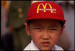 A young boy wears a McDonald's cap in Beijing, China.