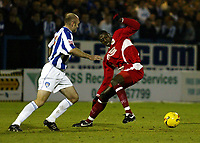 Photo: Chris Ratcliffe.<br />Colchester United v Bristol City. Coca Cola League 1. 17/01/2006.<br />Bas Savage (R) of Bristol City chases down Wayne Brown of Colchester.