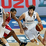 Efes Pilsen's Cenk AKYOL (R) during their Turkish Basketball league match Efes Pilsen between Tofas at the Sinan Erdem Arena in Istanbul Turkey on Sunday 27 February 2011. Photo by TURKPIX
