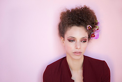 Young Woman with Orchids in Hair