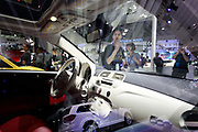 Visitors look at Fiat SpA 500 vehicles during the China ( Guangzhou) International Automobile Exhibition in Guangzhou, Guangdong Province, China, on Monday, Nov. 21, 2011. Despite signs of slowing, China remains the largest and fastest growing market for international car makers, especially in the luxury sector.