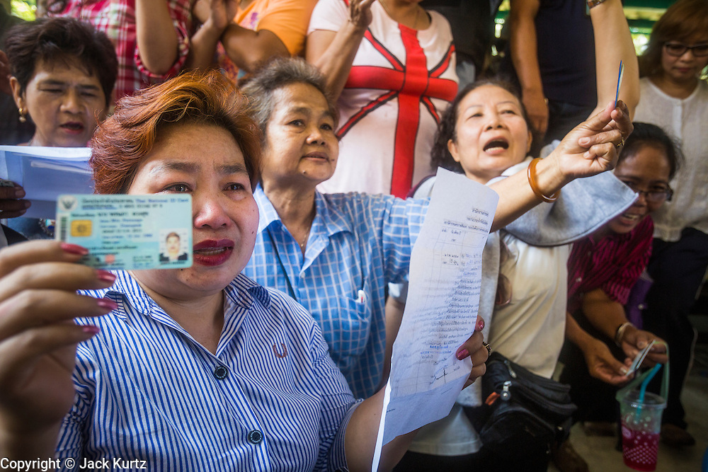 """01 FEBRUARY 2014 - BANGKOK, THAILAND: Thai women try to get into the election offices in Din Daeng to vote Sunday. The polls in Din Daeng never opened because anti-government protestors blocked access to the polls. Thais went to the polls in a """"snap election"""" Sunday called in December after Prime Minister Yingluck Shinawatra dissolved the parliament in the face of large anti-government protests in Bangkok. The anti-government opposition, led by the People's Democratic Reform Committee (PDRC), called for a boycott of the election and threatened to disrupt voting. Many polling places in Bangkok were closed by protestors who blocked access to the polls or distribution of ballots. The result of the election are likely to be contested in the Thai Constitutional Court and may be invalidated because there won't be quorum in the Thai parliament.    PHOTO BY JACK KURTZ"""