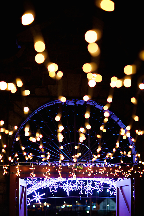 Stars and fairy lights glowing at Liberty Wharf, St Helier, Jersey at Christmas time