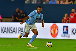 Manchester City midfielder Raheem Sterling (7) takes the ball down field during play a the International Champions Cup match between Manchester United and Manchester City at NRG Stadium in Houston, Texas