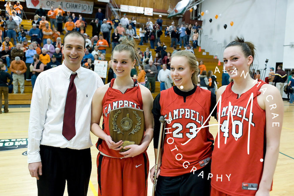 Campbell head basketball coach Shawn Flynn, along with seniors Lindsay Delude, Kristen Lang and Michelle Desorchers pose with Campbells runner up plaque at the conclusion of Monday's NHIAA Class M championship game against Conant at Plymouth State University.  (Alan MacRae/for the Hudson Litchfield News)