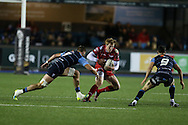 Rhys Patchell of the Scarlets  goes past Cam Dolan (l) and Tomos Williams of Cardiff Blues ® .  Guinness Pro12 rugby match, Cardiff Blues v Scarlets at the BT Cardiff Arms Park in Cardiff, South Wales on Friday 28th October 2016.<br /> pic by Andrew Orchard, Andrew Orchard sports photography.