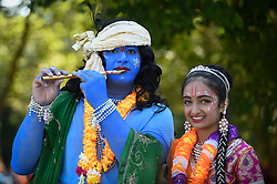 © Licensed to London News Pictures. 02/09/2018. WATFORD, UK.  (L to R) Kushal and Shivanee, students at Avanti School in Stanmore, dress as Lord Krishna and his consort Radharani as thousands of devotees attend the biggest Janmashtami festival outside of India at the Bhaktivedanta Manor Hare Krishna Temple in Watford, Hertfordshire.  The event, which celebrates the birth of Lord Krishna, includes a cultural and spiritual festival at a property donated to the Hare Krishna movement by ex Beatle George Harrison.  Photo credit: Stephen Chung/LNP