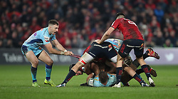 Exeter Chiefs's Nic White pulls on a munster players shirt during the Heineken European Challenge Cup, pool two match at Thomond Park, Limerick.