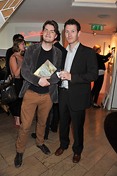 Left to right, actors TOM BURKE and NICK MORAN at a party to celebrate the publication on The House of Rumour by Jake Arnott held at The Ivy Club, West Street, London on 9th July 2012.