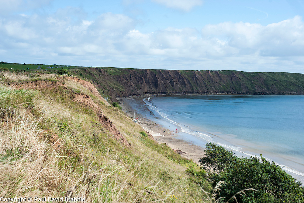 View across the clifftops from North Filey, above Coble Landing, towards Filey Brigg