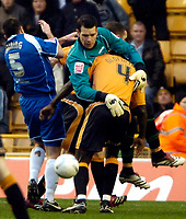 Photo: Ed Godden/Sportsbeat Images.<br />Wolverhampton Wanderers v Oldham Athletic. The FA Cup. 06/01/2007. Oldham's keeper Les Pogliacomi struggles with Seyi Olofinjana for the ball.