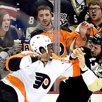 Pittsburgh Penguins center Tanner Glass (10) and Philadelphia Flyers right wing Wayne Simmonds (17) receives cheers from their fans as the fight each other in the first period at the Consol Energy Center in Pittsburgh on February 20, 2013.   UPI/Archie Carpenter