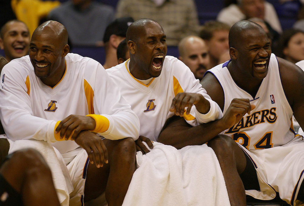 The Lakers' Karl Malone, Gary Payton and Shaquille O'Neal laugh while teasing Kobe Bryant after former Clipper Lamar Odom dunked over him during the 4th quarter of the Lakers' 99-77 victory over the Miami Heat Sunday November 16, 2003 at Staples Center.