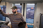 28 DECEMBER 2008 -- PHOENIX, AZ: CALVIN DeVOLL, from Phoenix, rides the new Metro light rail for the first time Sunday. The new Metro Light Rail is 20 miles long and cost $1.4 billion dollars. Construction was funded by local, state and federal monies. The trains will operate on one line through Phoenix and the suburban communities of Tempe and Mesa. The trains started running Saturday, Dec 27, 2008 and will be free until Jan. 1, 2009. The regular fare will be $1.25 for one ride or $2.50 for an all day pass.  Photo by Jack Kurtz / ZUMA Press