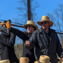 Gordonville, PA, USA - March 10, 2012: An Amish man looks for bids at a public mud sale to benefit the Gordonville Volunteer Fire Company in Lancaster County, PA.