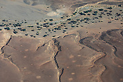 Aerial view of river beds, mountains and sand dunes of the Skeleton Coast,Namibia