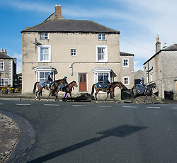 © Licensed to London News Pictures. 22/03/2014<br /> <br /> Middleham, North Yorkshire<br /> <br /> Race horses are ridden out through Middleham to exercise on the horse racing gallops in Middleham, North Yorkshire. Race horses have been trained in Middleham for over 200 years using the extensive gallops on the high moor. There are currently 15 stables based around the small Yorkshire village.<br /> <br /> Photo credit : Ian Forsyth/LNP