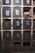 old bottles in the cellar chalk board domaine doudet naudin savigny-les-beaune cote de beaune burgundy france