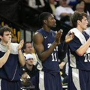 Players from Rice cheer during the first half of  a Conference USA NCAA basketball game between the Rice Owls and the Central Florida Knights at the UCF Arena on January 22, 2011 in Orlando, Florida. Rice won the game 57-50 and extended the Knights losing streak to 4 games.  (AP Photo/Alex Menendez)