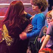 NLD/Hilversum /20131213 - Halve finale The Voice of Holland 2013, Trijntje Oosterhuis knuffelt haar kinderen