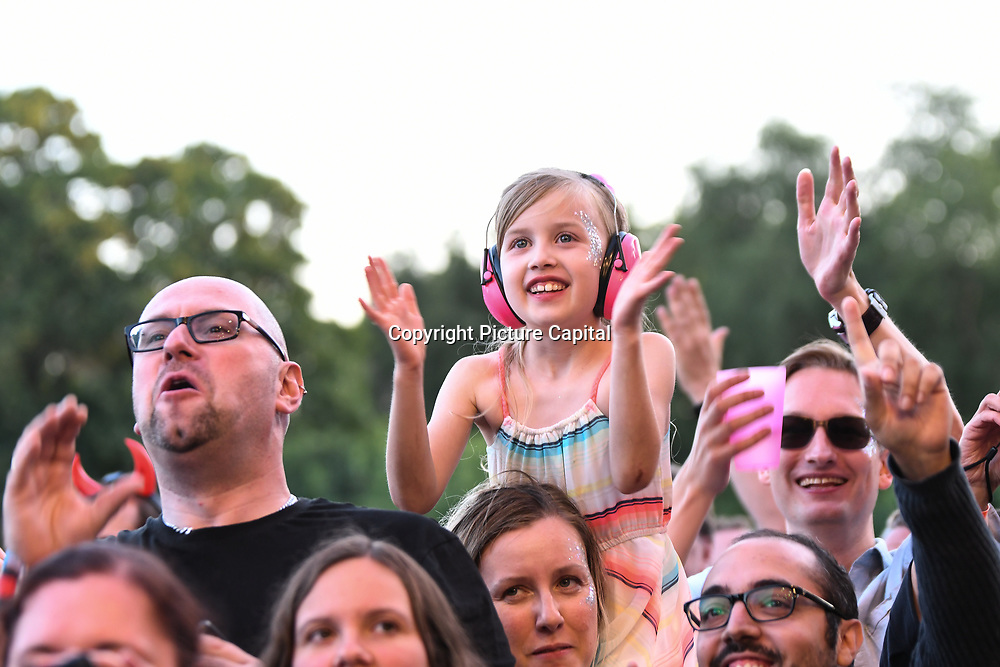 Thousands attend and having fun dancing at the Kew The Music Festival 2018 at kew Garden, London, UK.
