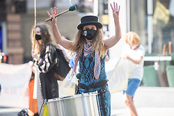 © Licensed to London News Pictures. 01/09/2020. Manchester, UK. A drummer with an XR face mask at an Extinction Rebellion protest in Manchester. Photo credit: Kerry Elsworth/LNP