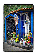 SHOT 2/3/18 5:01:49 PM - A capilla dedicated to Santa Muerte (Nuestra Señora de la Santa Muerte) near El Guamuchil, Mexico. Santa Muerte (Holy Death), is a female deity (or folk saint depending on school of thought) in Mexican folk religion, particularly Folk Catholicism, venerated primarily in Mexico and the Southwestern United States. A personification of death, she is associated with healing, protection, and safe delivery to the afterlife by her devotees. Despite condemnation by the Catholic Church her devotees have grown in numbers lately and many followers of Santa Muerte live on the margins of the law or outside it entirely.  In the Mexican and U.S. press, the Santa Muerte cult is often associated with violence, criminality, and the illegal drug trade. Altars of Santa Muerte temples generally contain one or multiple images of the Lady, generally surrounded by any or all of the following: cigarettes, flowers, fruit, incense, water, alcoholic beverages, coins, candies and candles. Capillas are common along the roads and highways of Mexico which is heavily Catholic and are often dedicated to certain patron saints or to the memory of a loved one that has passed away. Often times they contain prayer candles, pictures, personal artifacts or notes. (Photo by Marc Piscotty / © 2018)