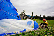 A smokejumper lands with his parachute still billowing during a training exercise in an open field outside of McCall, ID.