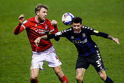 Marvin Johnson of Middlesbrough challenges Joe Worrall of Nottingham Forest - Mandatory by-line: Robbie Stephenson/JMP - 20/01/2021 - FOOTBALL - City Ground - Nottingham, England - Nottingham Forest v Middlesbrough - Sky Bet Championship