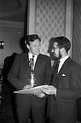 """23/03/1963<br /> 03/23/1963<br /> 23 March 1963<br /> Gaelic Sports Journalists Association Presentation off Awards at the Anchor Hotel, Dublin. Picture shows Kevin Coffey of Kerry (who accepted the football award for team mate Mick O'Connell) admiring the certificate awarded to film director Louis Marcus (right) for his direction of the Wills/Gael - Linn Gaelic Football film, """"Peil""""."""