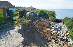 ©Licensed to London News Pictures 06/08/2020 Eastchurch, UK. The remains of the collapsed property.  Residents in Eastchurch on the Isle of Sheppey, Kent have been advised to move by the local council as their homes are at risk from landslides. The advice comes ten weeks after a massive landslide destroyed a family home and sent it tumbling down a cliff leaving the family homeless. Photo credit: Grant Falvey/LNP