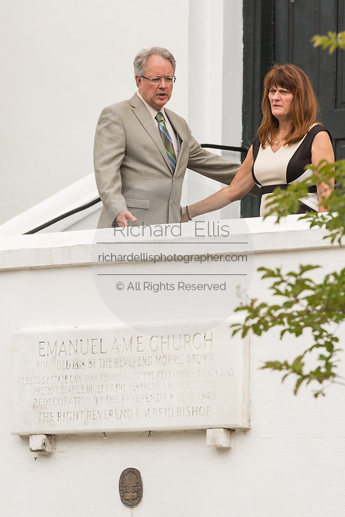 The Mayor of Charleston John Tecklenburg and his wife Sandy stand at  the Emanuel AME Church on the anniversary of the mass shooting of nine members June 18, 2016 in Charleston, South Carolina. Nine members of the historic Mother Emanuel African Methodist Episcopal Church were gunned down during bible study at the church on June 17, 2015.