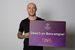 """CARDIFF, WALES - Monday, November 7, 2016: Wales' David Cotterill holds up a board """"Dewch yn Bencampwr"""" to encourage people to become volunteers for the 2017 UEFA Champions League Final in Cardiff. (Pic by David Rawcliffe/Propaganda)"""