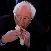 Senator Bernie Sanders, an independent from Vermont and 2016 Democratic presidential candidate, eats a hot dog from Nathan's Famous Inc. in Coney Island after a campaign event in the Brooklyn borough of New York, U.S., on Sunday, April 10, 2016. Sanders secured his seventh consecutive nominating-contest victory after voters caucused in Wyoming, to give his campaign a fresh shot of momentum heading into New Yorks pivotal primary later this month. Photographer: John Taggart/Bloomberg *** Local Caption *** Bernie Sanders