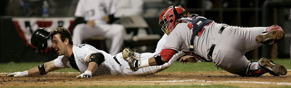 LA Angels v Chicago White Sox - Game 2 ALCS.Chicago's Aaron Rowand (33) slides in to home plate as he is tagged out by LA's catcher Jose Molina (28) in the second inning. .
