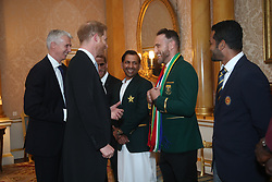 The Duke of Sussex meets South Africa cricket captain Francois du Plessis (centre), Pakistan captain Sarfaraz Ahmed (left) and Sri Lanka captain Dimuth Karunaratne (right). The captains of the teams taking part in the ICC Cricket World Cup meet for a photograph in the 1844 Room at Buckingham Palace in London, ahead of the competition's Opening Party on the Mall.