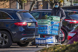 © Licensed to London News Pictures. 04/11/2020. London, UK. Shoppers are seen pushing full trolleys at Costco in Chingford, north London as a second national lockdown is announced for Thursday [05/11/2020].Photo credit: Marcin Nowak/LNP