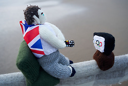 © Licensed to London News Pictures. 27/07/2012..Saltburn, England..The mysterious group known as the yarn bombers have returned the knitted Olympic figures to Saltburn Pier. ..After being removed recently for repairs the mysterious group returned with the knitted figures in the dead of night and endured heavy rain as they worked by torchlight on the pier in the early hours of the morning. As daylight came, the figures including some new additions were back once again on the pier. ..Photo credit : Ian Forsyth/LNP